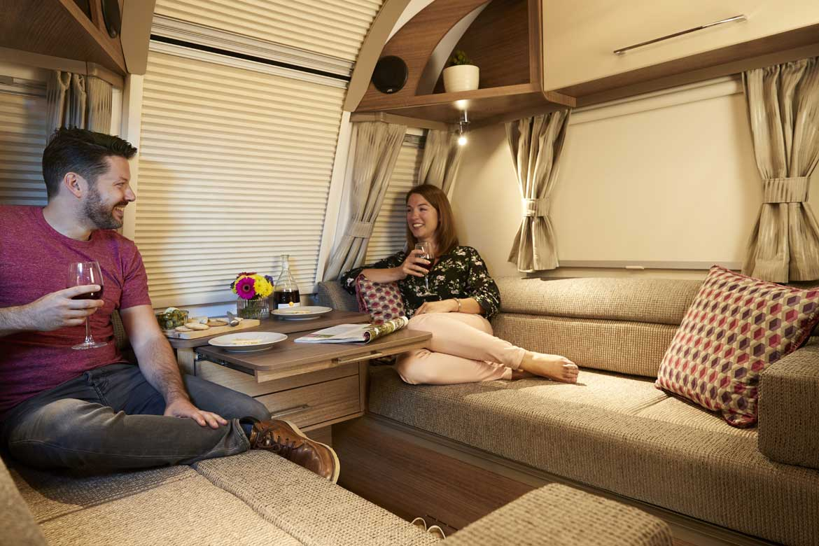 Bailey Phoenix couple relaxing caravan