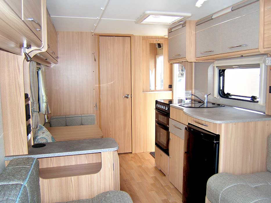 A general view looking back through the caravan past the dinette and kitchen area from the front lounge.