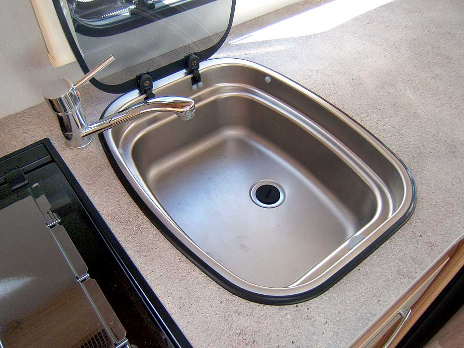 The inset stainless steel sink.