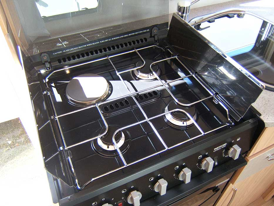 The hob unit with 3 gas burners and 1 electric hotplate.