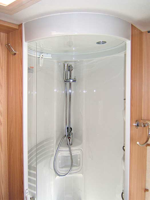 The top section of the shower cubicle with shower unit.