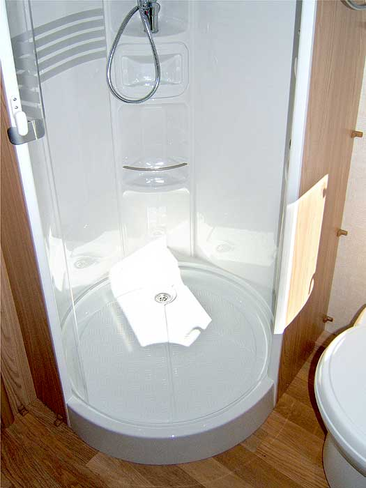 The shower cubicle tray.