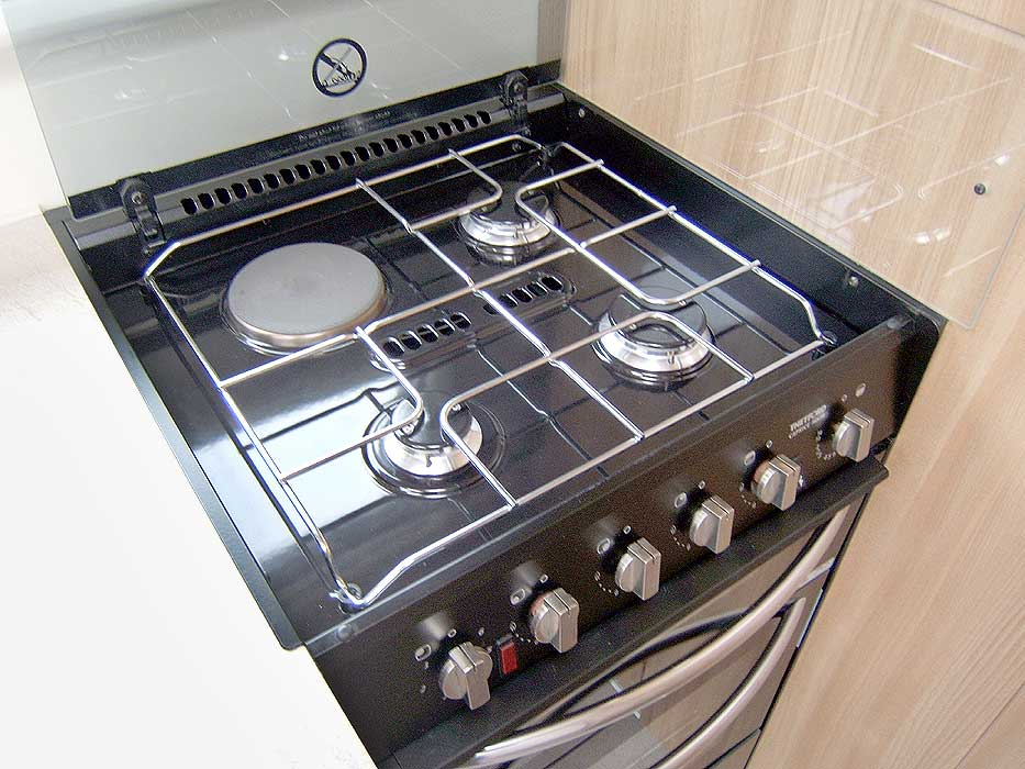 The kitchen is fitted with a stainless steel microwave.