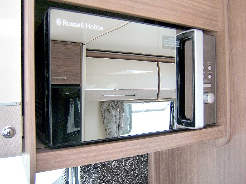 The kitchen has a worktop extension flap. Handy for meal preparation. Fold away when not needed.