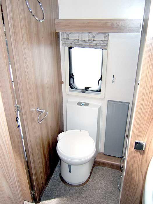 View of the fridge interior with freezer top box.