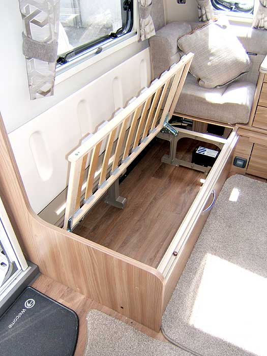 Removing the seat cushions gives full access to the space beneath the seats.