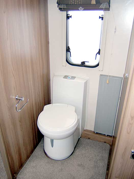 A general view of the bedroom with fixed double bed.