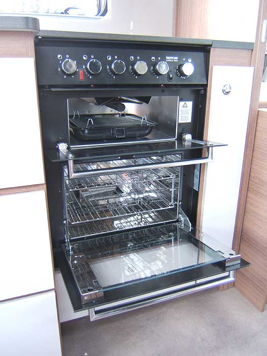 Close-up of the inset, stainless steel kitchen sink.
