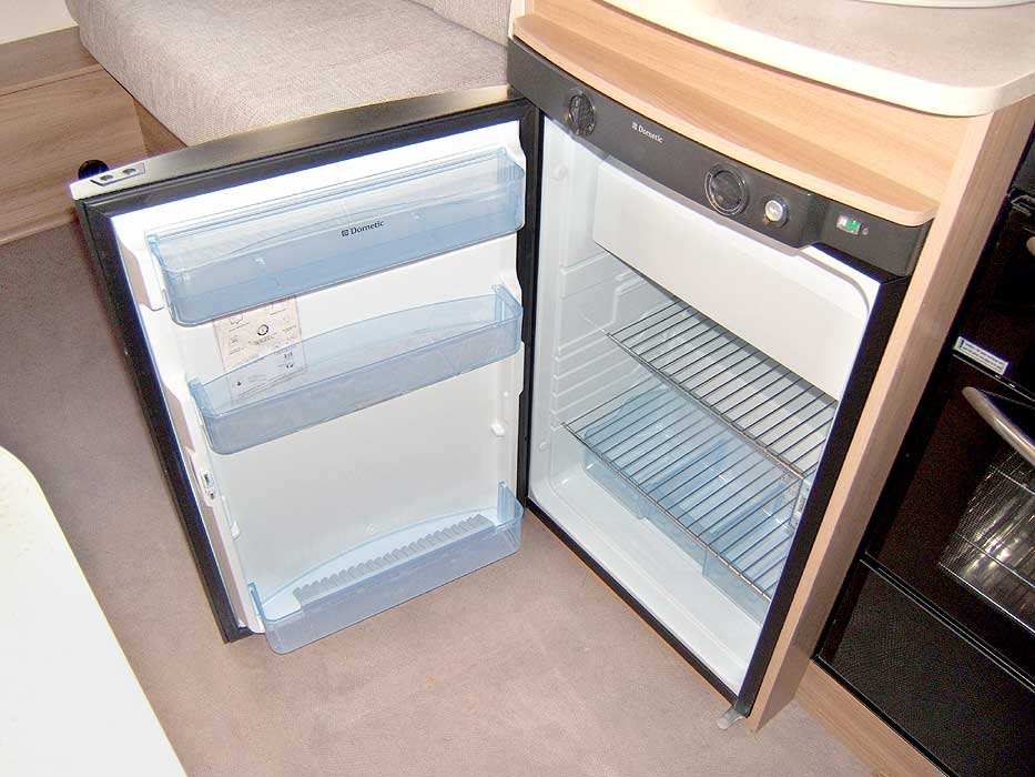 The Dometic hob with 3 gas burners and an electric hotplate.