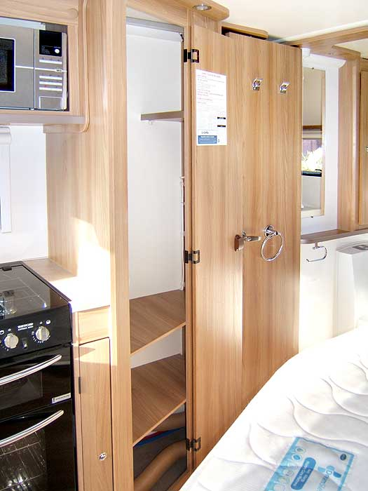 The interior of the large capacity fridge with freezer top box.