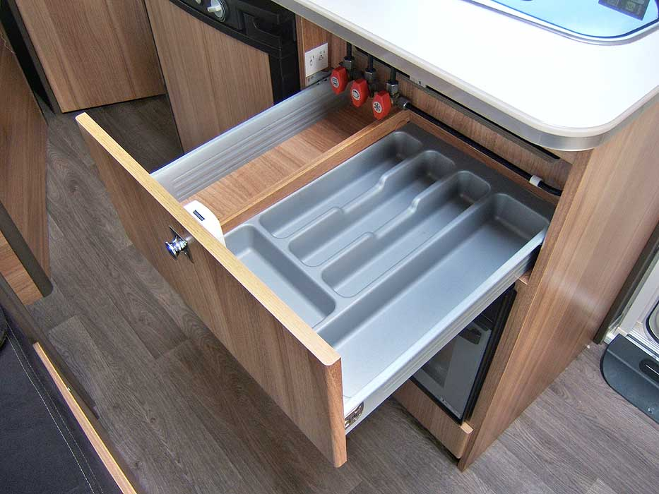 The drawer beneath the worktop with cutlery tray.