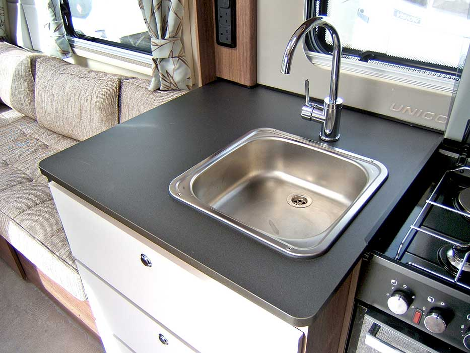 The inset, stainless steel sink with single mixer tap.