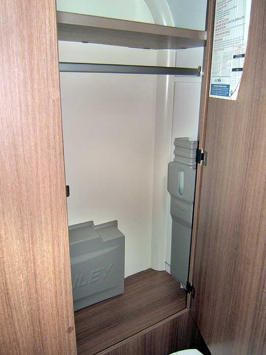 The large wardrobe with hanging rail in the washroom.